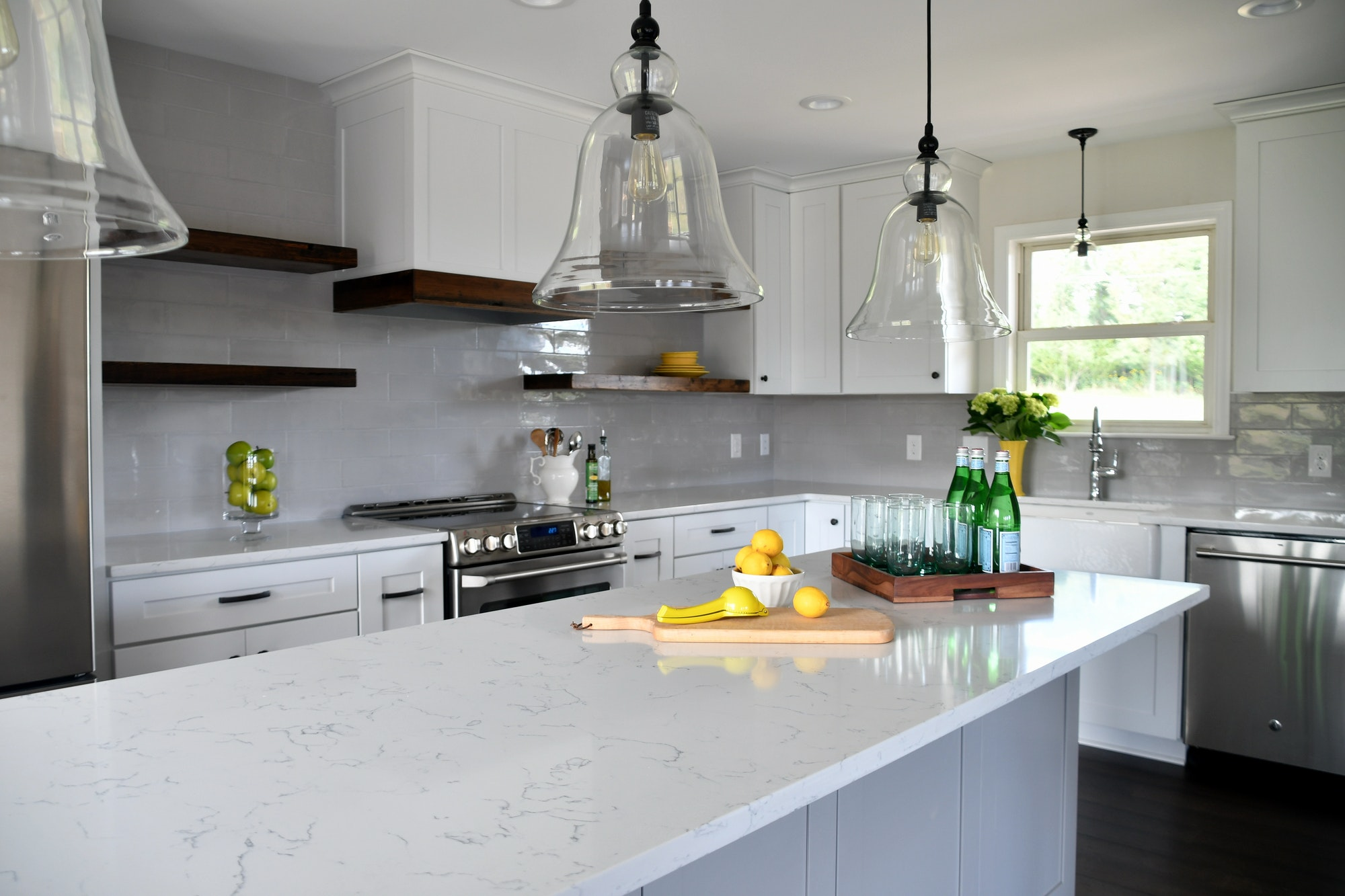 Bright cheery kitchen in a new home with open concept layout, light and airy